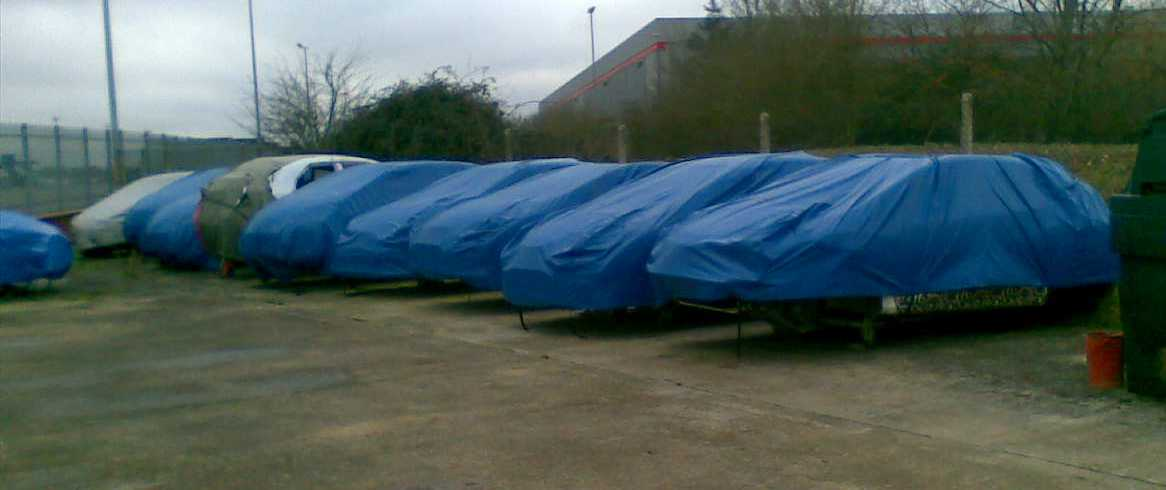covers over a row of cars